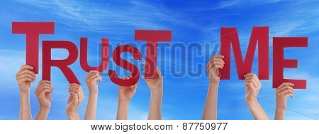 People Hands Holding Red Word Trust Me Blue Sky