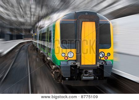 Fast Speed Train With Radial Blur. Commuter Transport