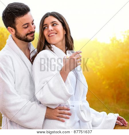 Cute Young Couple In Bathrobe.