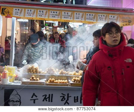 Traditional Korean Street Food Market Scene  At Myeongdong District In Seoul,south Korea