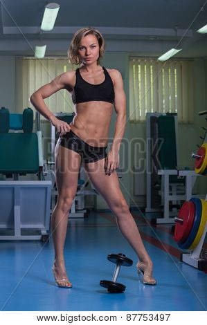 Sports, bodybuilding. Attractive woman in gym.Fitness in the gym.