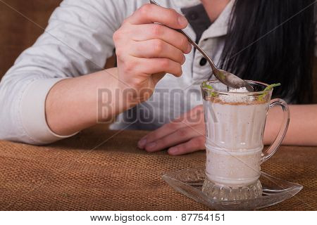 Woman eating dairy dessert spoon.