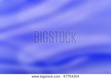 blue silk folds of fabric, closeup