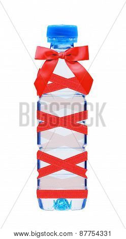 Blue Bottle Of Water With Red Bow Isolated On White