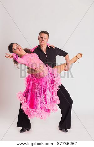Man and woman posing in dance pose on white