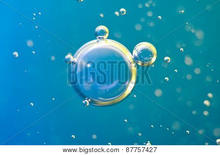 Macro Oxygen Bubbles In Water On Blue Background