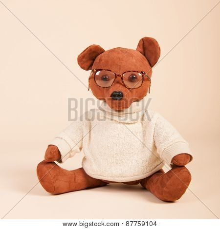 Stuffed bear with glasses and sweater