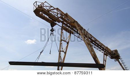 Gantry Crane Lifts And Moves A Pack With Metal Reinforcement