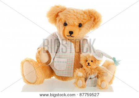 Stuffed bear in pajamas isolated over white background