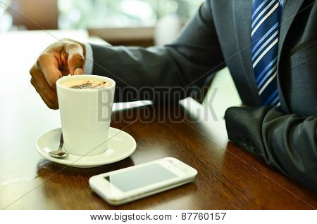 Cropped Image Of Businessman At Coffee Shop