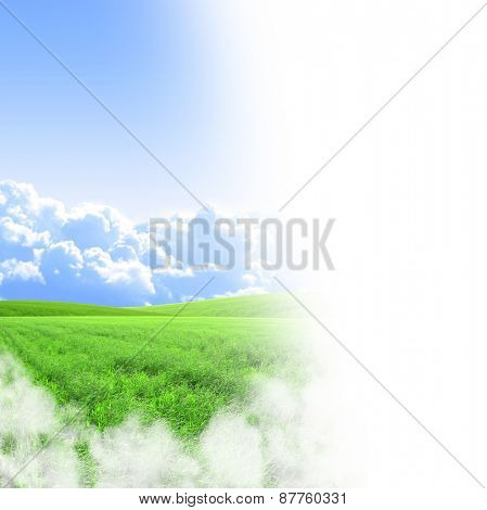 A green field and blue sky on white background
