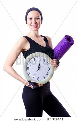Female sportsman holding rug and clock isolated on white