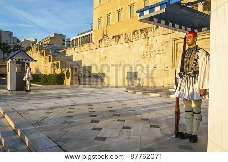 ATHENS, GREECE - APR 12, 2015: Evzone guarding the Tomb of the Unknown Soldier in Athens dressed in full dress uniform, refers to the members of the Presidential Guard, an elite ceremonial unit.