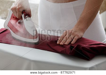 Men Ironing His Pants