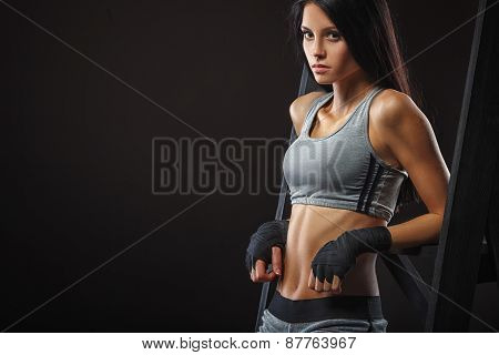woman boxer sitting on chair