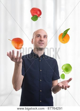 Man Juggle Fruits