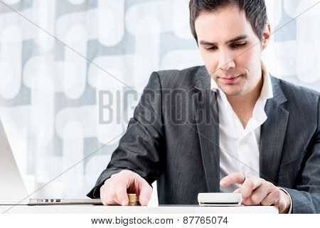 Young Male Accountant Calculating Earnings And Profit