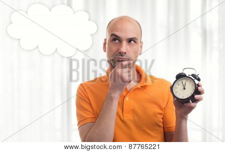 Man Holding Alarm Clock, Thinking And Looking Up