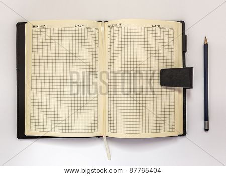 Diary And Pencil On A White Background