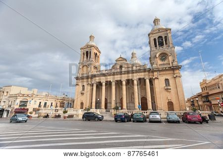 PAOLA, MALTA - JANUARY 12, 2015: Cars parked in front of Church of Christ the King.