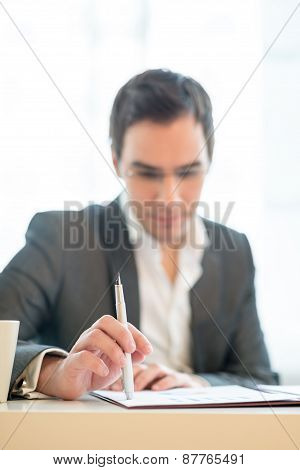 Businessman Sitting Pondering A Document