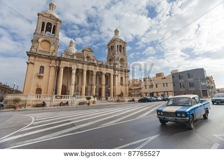 PAOLA, MALTA - JANUARY 12, 2015: Cars passing by the Church of Christ the King.
