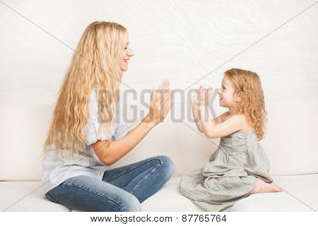 Mother playing with baby at home