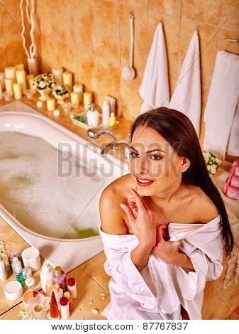 Woman relaxing at home luxury bath. Girl sitting on edge of bath.