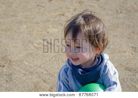 Smiling Boy In Playground