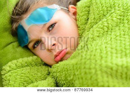 Sick Child Girl Under A Blanket