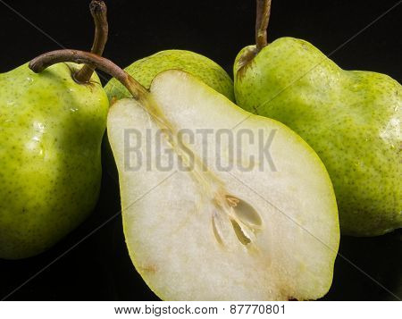 group of pears and half pear