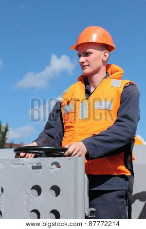 SEVASTOPOL, CRIMEA, UKRAINE - AUGUST 17, 2012: Seaman at capstan on the Russian frigate