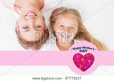 happy mothers day against mother and daughter smiling at camera