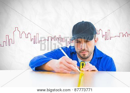 Worker measuring table against crumpled white page