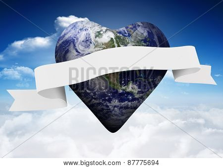 Heart shaped earth with scroll against bright blue sky with clouds