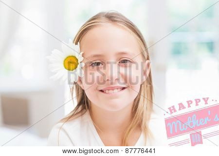 mothers day greeting against cute little girl smiling at camera