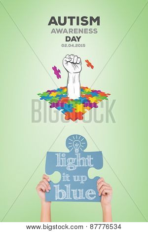 Hands showing jigsaw puzzle against green vignette