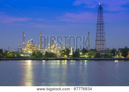 Oil refinery plant at twilight alrong with Chao Phraya river, Thailand