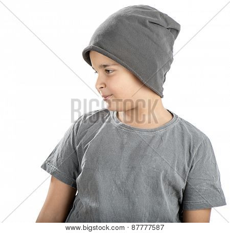 Cute boy wearing beanie looking at space for your text isolated on white background.