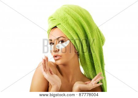 Spa serene woman with gel eye mask