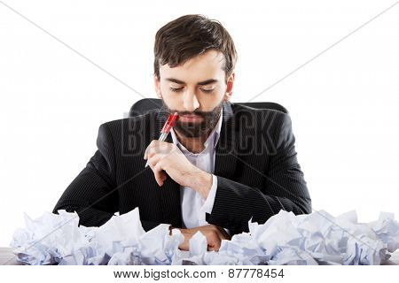 Pensive businessman in the office trying to find an idea.