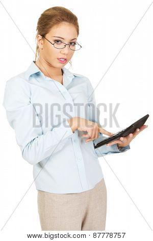 Beautiful bank employee with pocket calculator.