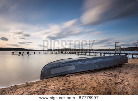 Long Exposure Lake With Boat On Shore