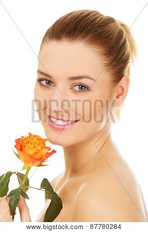 Portrait of beautiful caucasian woman with rose. Spa concept.