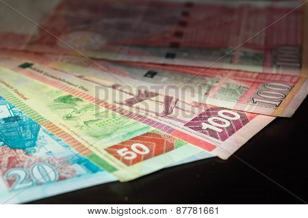 Hong Kong Dollars Against A Dark Background