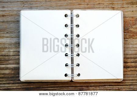 An empty retro notebook with old paper and little pencil