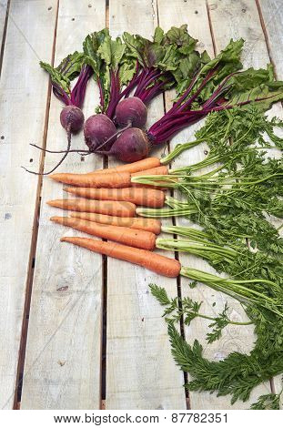 Carrot And Beetroot Bunch On White Wood