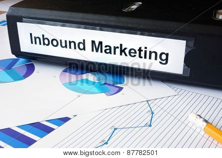 Graphs and file folder with label Inbound Marketing.