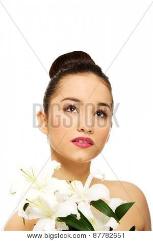 Beauty face of young woman with lily flower.