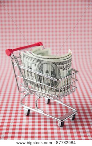Pack of dollars in shopping cart